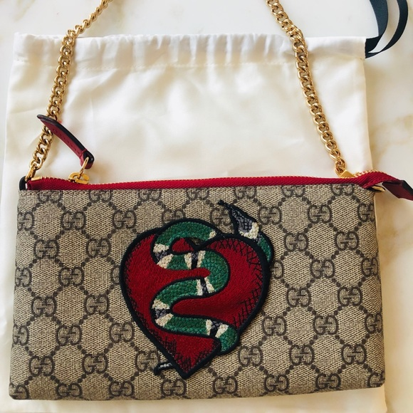 704757dca8d5 Gucci Handbags - Authentic Gucci Embroidered Chain Wrist Wallet.